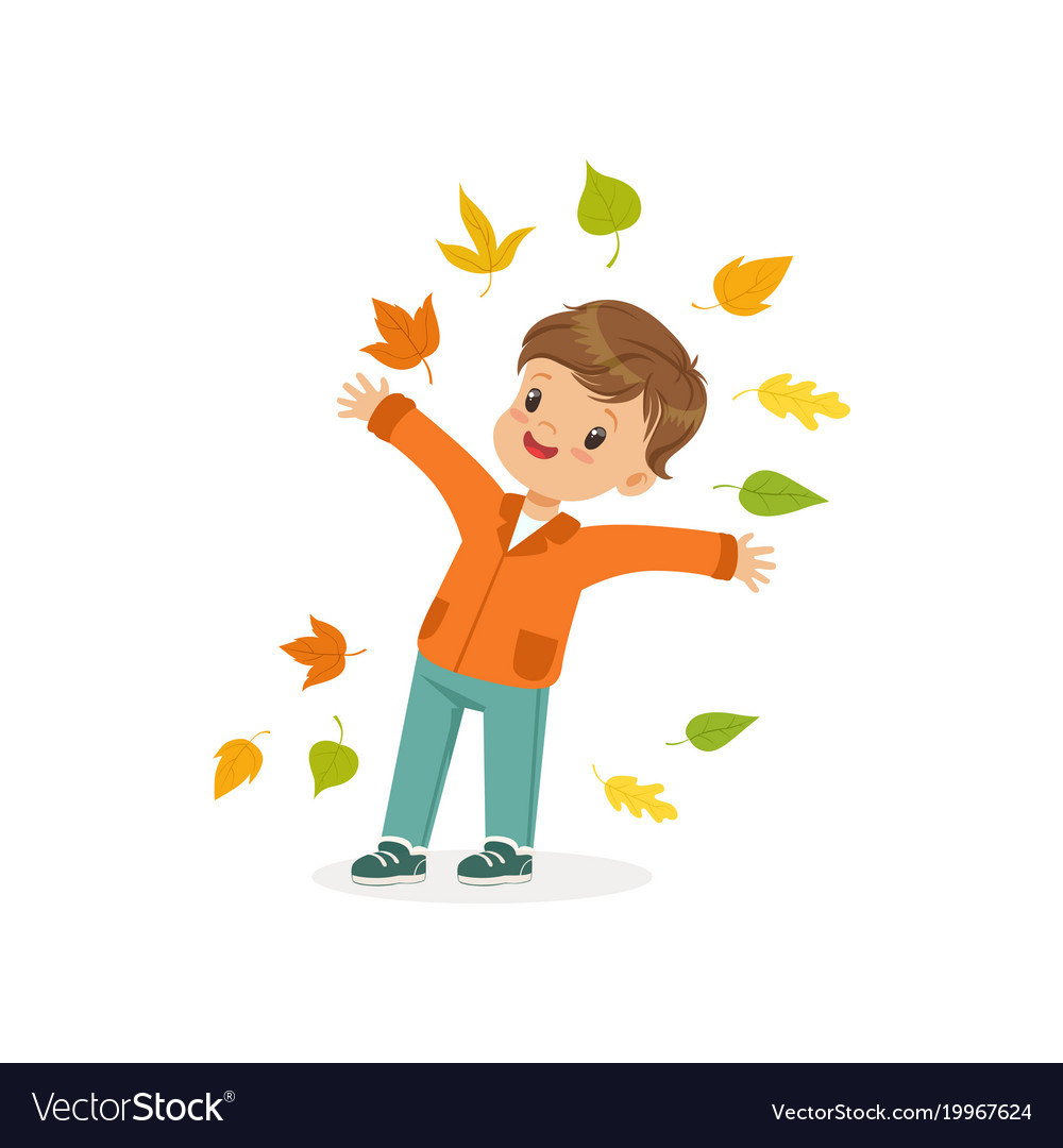 Cute little boy throwing colorful autumn leaves up.
