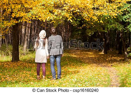 Stock Photo of Back view of Young couple in love on the big autumn.