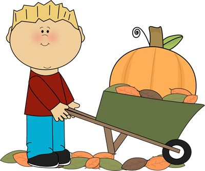 Boy with pumpkin in a wheelbarrow..