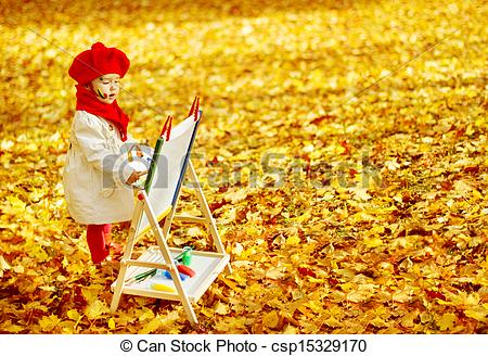 Picture of Child drawing on easel in Autumn Park. Creative kids.