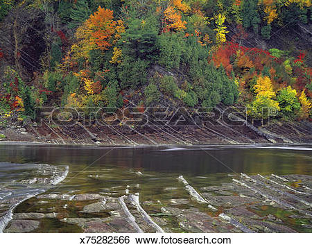 Stock Images of Canada, Quebec, river and autumn trees in Chute de.