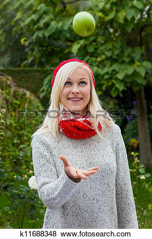Pictures of woman with apple. vitamins in autumn k11688348.