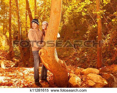 Stock Image of Pretty youth in autumn woods k11281615.