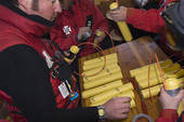 Stock Photograph of Ski patrollers preparing explosives for.