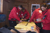 Picture of Ski patrollers preparing explosives for avalanche.
