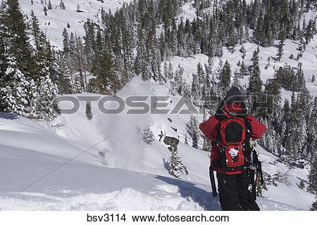 Stock Photo of A ski patroller throwing explosives for avalanche.