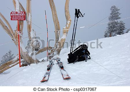 Picture of Ski equipment and sign warning about avalanche.