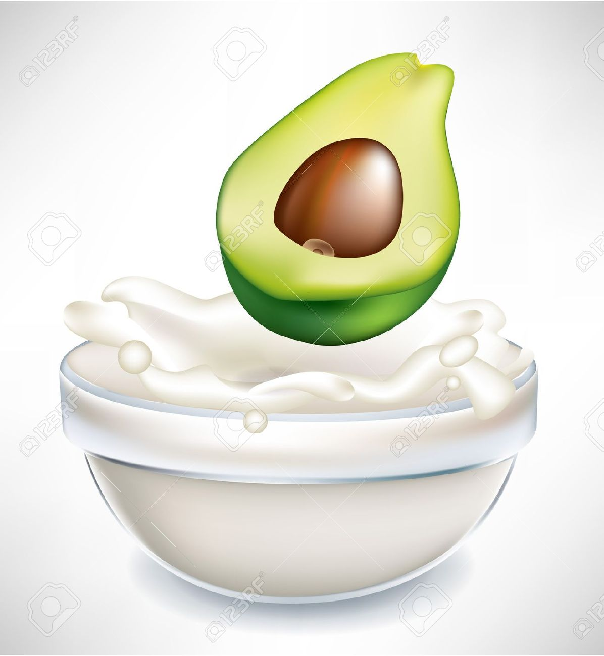 Avocado And Creamy Milk Splash In Transparent Bowl Isolated On.