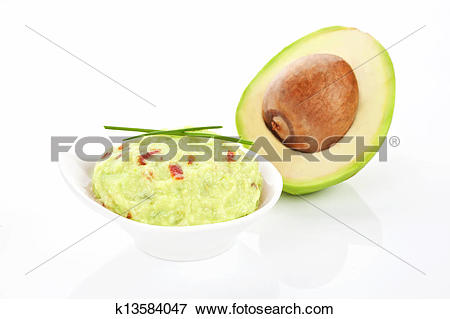 Picture of Avocado and guacamole dip isolated. k13584047.