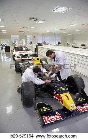 Stock Photo of Mechanics working on racing car, World Series.