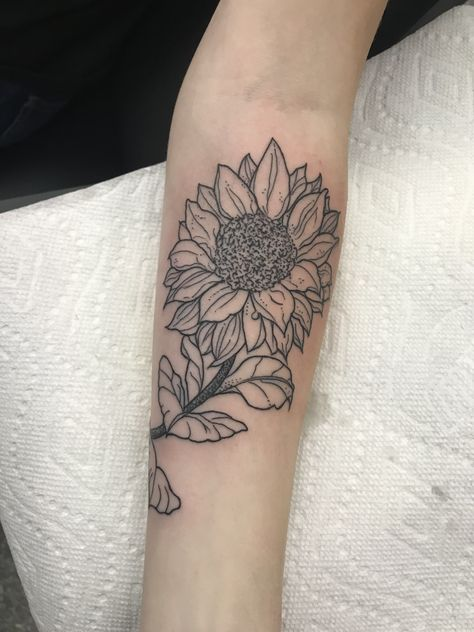 Sunflower Outline minimalist black ink lady tattoo.