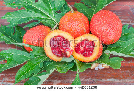 Gac Fruit On Old Wooden Table Stock Photo 442601239.