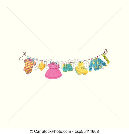 Baby clothes hanging on rope. Striped bodysuit, little cap with ears, pink  dress, shorts, blouse, warm pullover and sock. Stylish garment for toddler.