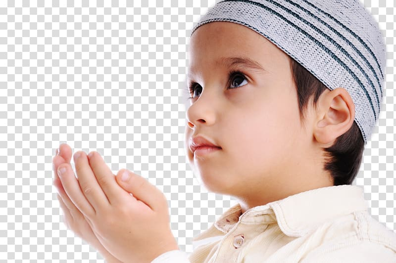 Boy putting hands together while looking up, Quran Islam.