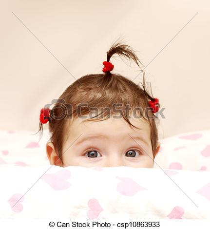 Stock Photos of Curious baby girl, with cute rubber hair ties.