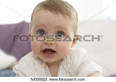 Stock Photo of Portrait of baby girl with open mouth showing first.