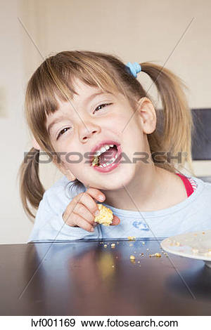 Stock Photograph of Portrait of little girl eating cake with open.