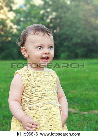Stock Images of Happy baby girl looking with open mouth on nature.