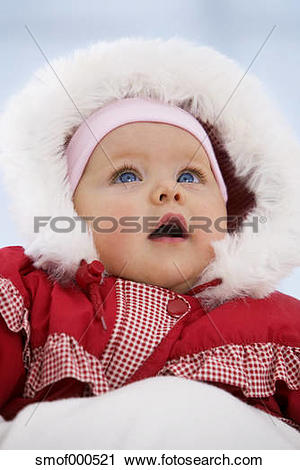 Stock Photography of Baby girl in snow suit with mouth open.