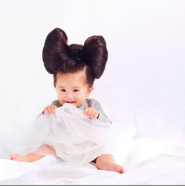 Baby goes viral for thick hair and becomes shampoo model.