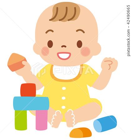 Baby playing building blocks.