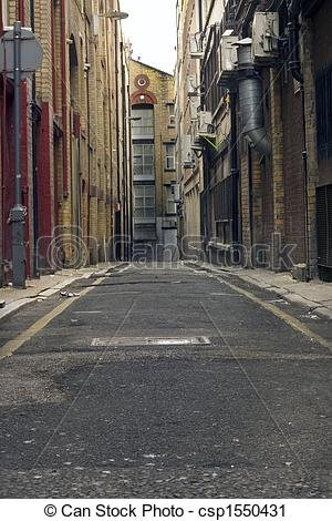 Stock Photography of Looking down a long dark back alley.