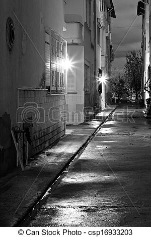 Stock Photography of Dark back alley on a wet night.