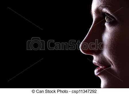 Stock Photographs of Backlit portrait of caucasian woman profile.