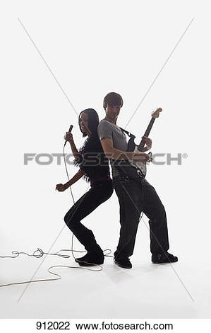 Stock Photo of A female singer and a man playing electric guitar.