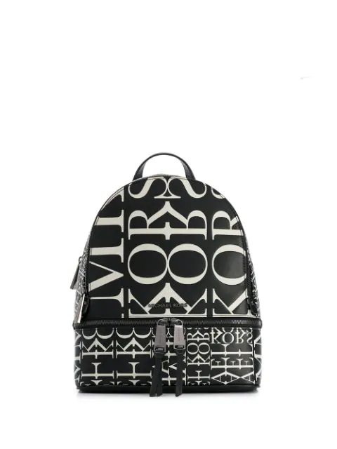 Rhea Medium Newsprint Logo Backpack In Black.