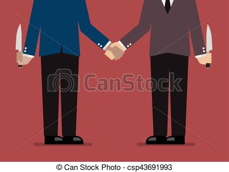 Closeup of business handshake with a knife hidden behind.