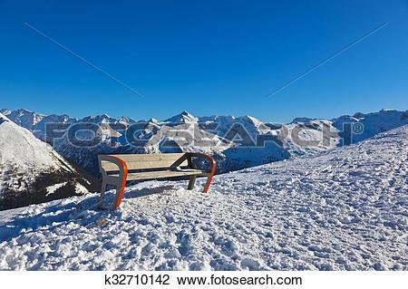 Stock Photo of Bench at mountains ski resort Bad Gastein.
