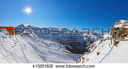 Stock Photo of Suspension bridge at mountains ski resort Bad.