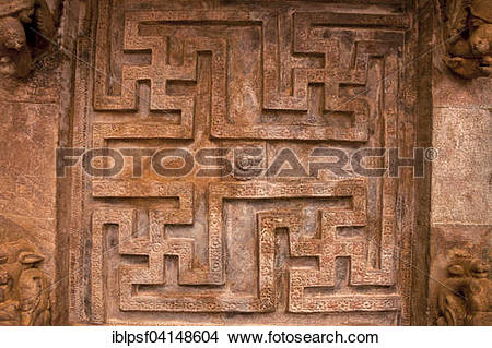 Stock Photo of Swastika relief in the cave temple of Badami.