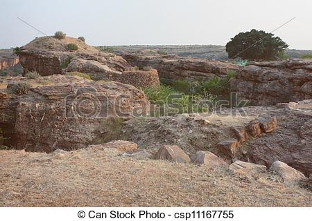 Stock Images of Fort atop rocky mountain and cave temples at.