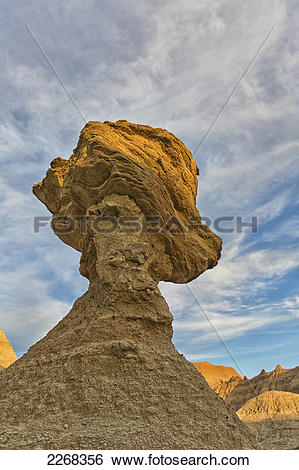 Stock Images of A large hoodoo balanced on a pedestal badlands.