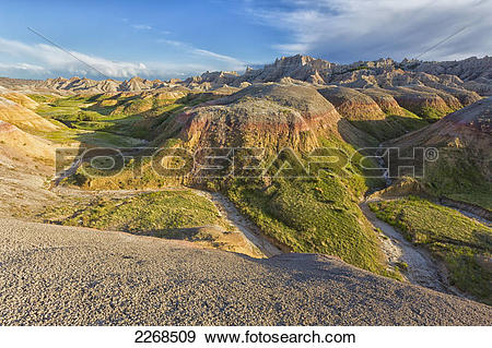 Stock Photograph of The yellow mounds area at sunset in badlands.