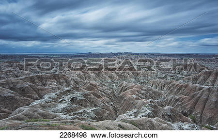 Pictures of Long exposure of clouds overtop of badlands national.