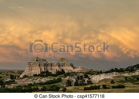 Stock Photography of Badlands stormy sunset.