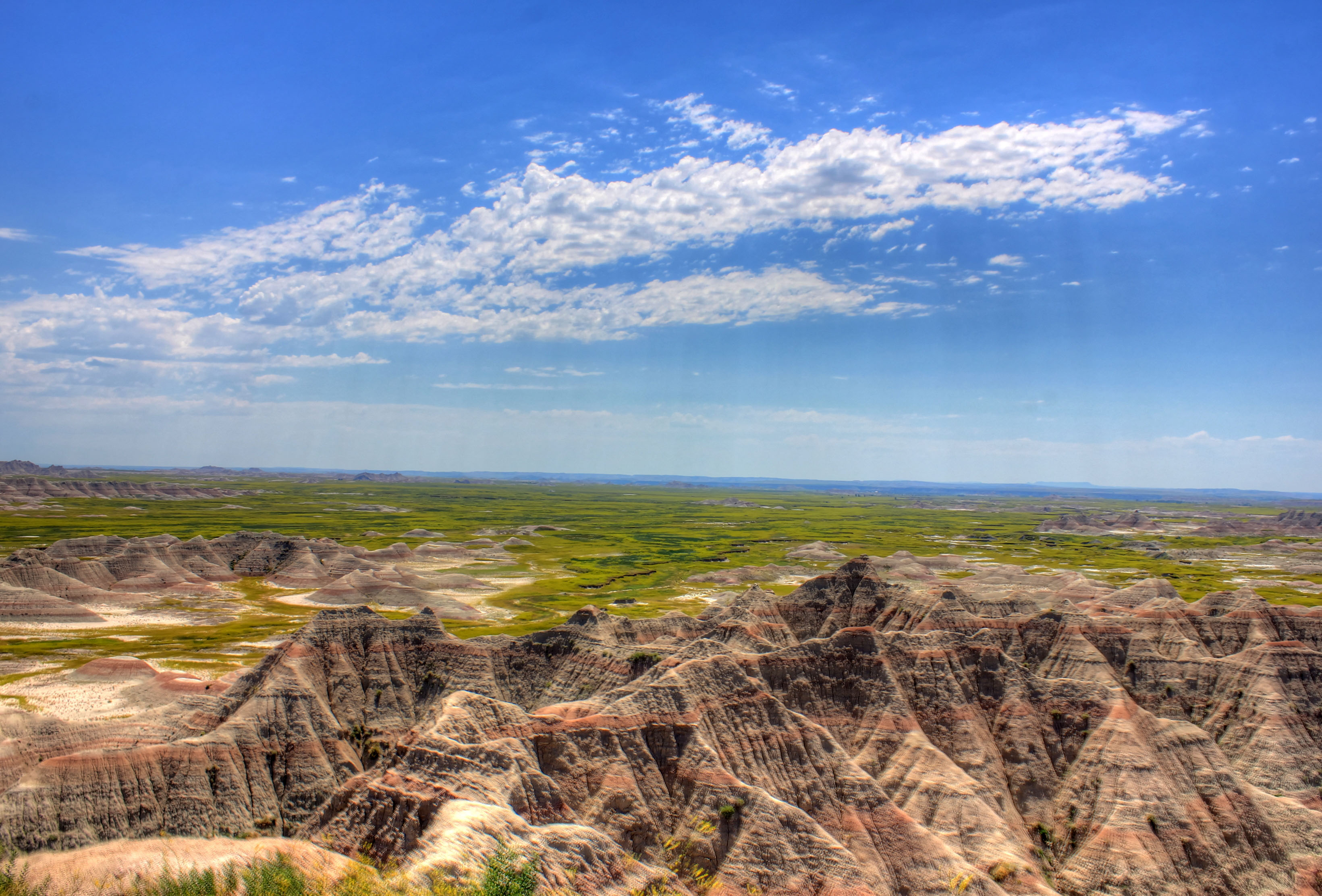 Buttes under clouds and skies at Badlands National Park, South.