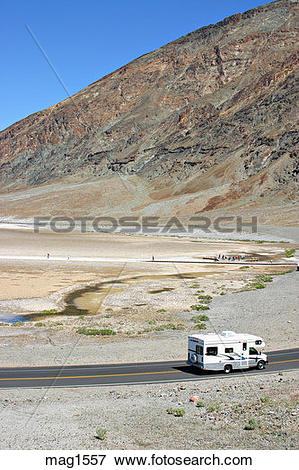 Picture of RV passing people at Badwater in Death Valley National.