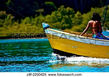 Stock Image of Woman sailing on a wooden boat in Baia de Todos os.