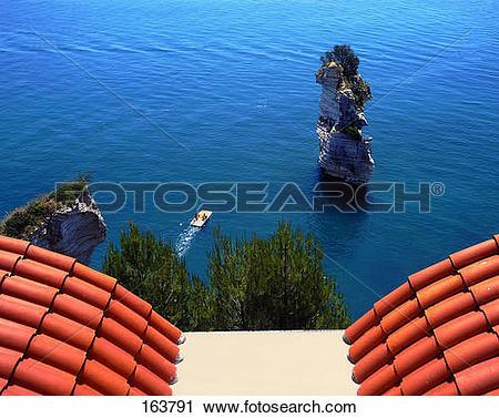 Stock Photography of Rock formations in sea, Baia Delle Zagare.