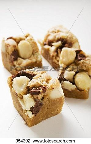 Stock Photo of Small pieces of chocolate slice with macadamia nuts.