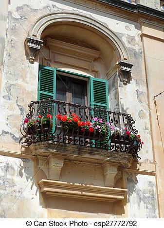 Stock Photographs of Old Ornate Iron Flower Balcony.