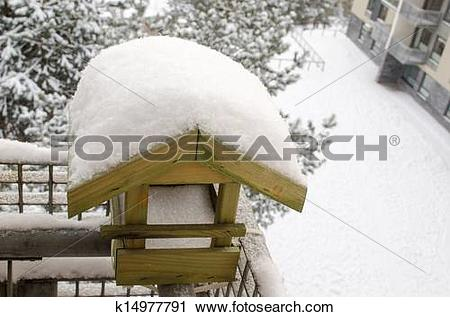 Stock Photography of snow covered roof nesting.