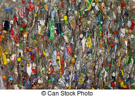 Stock Photographs of Plastic bottles baled for recycling.