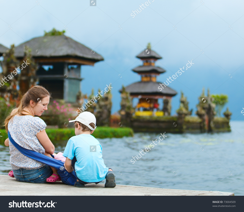 Family Enjoying Views Of Beautiful Bali Water Temple At Bratan.