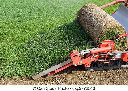 Stock Photography of Grass Baling Machine.