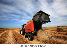 Stock Photography of Grass Baling Machine.